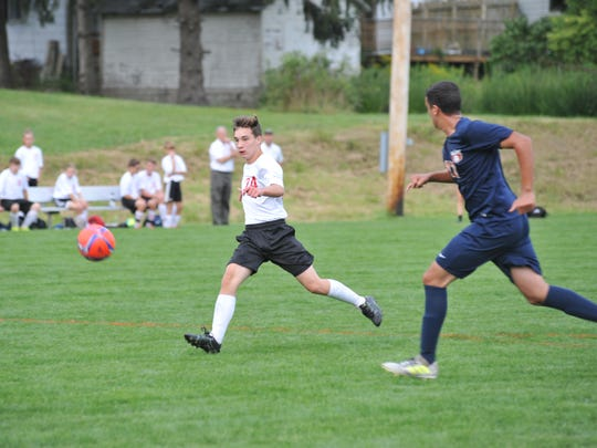 Mathew Babbs slots home one of his multiple goals Monday evening against Galion.