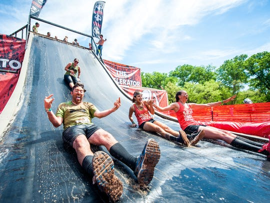Runners at Rugged Maniac can rocket down a large water
