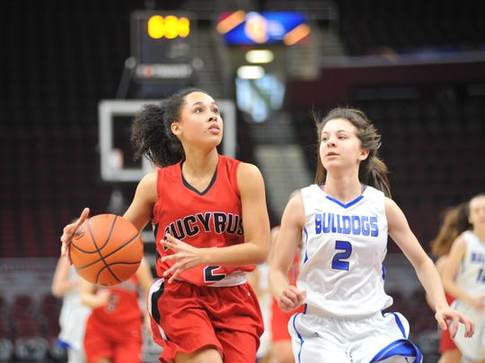 Ni'Georia Floyd drives to the basket with Crestline's Hannah Delong defending her.