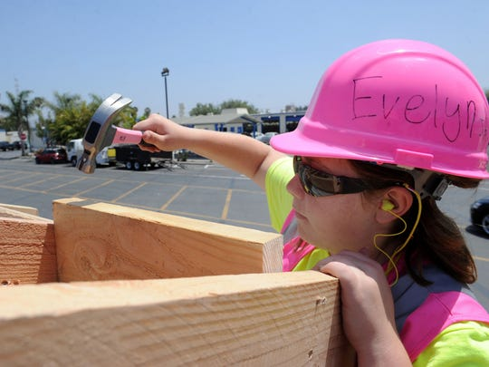 Evelyn Adams nails rafters in place on a tiny house being constructed this week at camp designed to introduce girls to the construction industry. The camp is being held in Camarillo at the Ventura County Office of Education's Career Education Center.