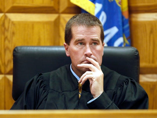 Judge Mark McGinnis should no longer be part of the Appleton Area School District's truancy court, an independent reviewer told the school board on Thursday.