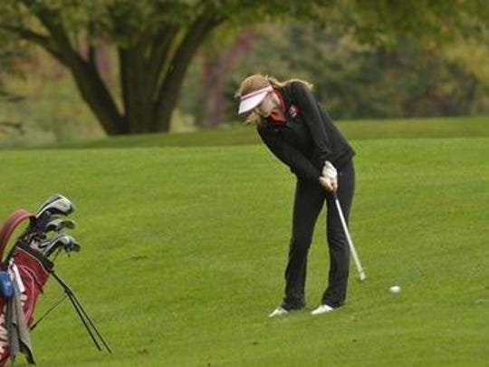 Chipping the ball during 2014 action is Canton's Meghan Meredith.