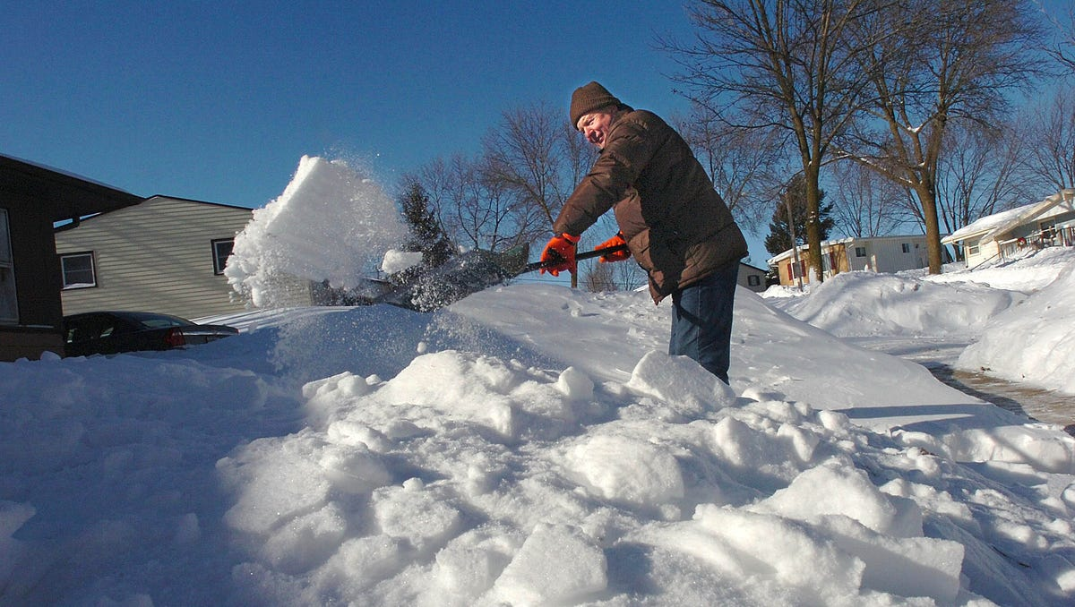 John Wilhelm shovels his front walk on Aldoro Drive in Waukesha on Dec. 20, 2008 after heavy snow, strong winds, and sub-zero temperatures moved through over the weekend.