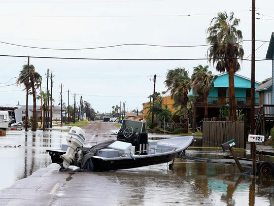 A boat is located in the middle of the street after