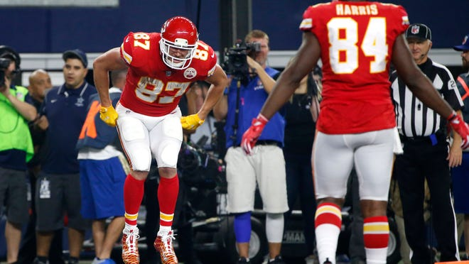Kansas City Chiefs' Travis Kelce (87) pretends to participate in a sack race as he celebrates catching a touchdown pass as tight end Demetrius Harris (84) watches in the second half of an NFL football game against the Dallas Cowboys on Sunday, Nov. 5, 2017, in Arlington, Texas. (AP Photo/Michael Ainsworth) ORG XMIT: OTKTG190