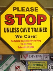 """The late Parker Turner developed and funded the """"Stop"""" signs placed in area underwater caves to warn off inexperienced divers."""