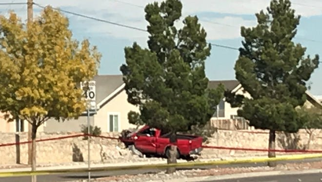 Police say this red truck was involved in a shooting Thursday in far East El Paso. A man and his daughter were found dead in a house, while a man was found dead in the truck.