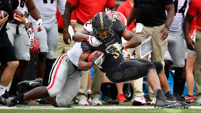 Georgia linebacker Monty Rice (32) tackles Vanderbilt running back Jamauri Wakefield (32) during the second half of an NCAA football game at Vanderbilt Stadium in Nashville, Tenn., Saturday, Oct. 7, 2017.