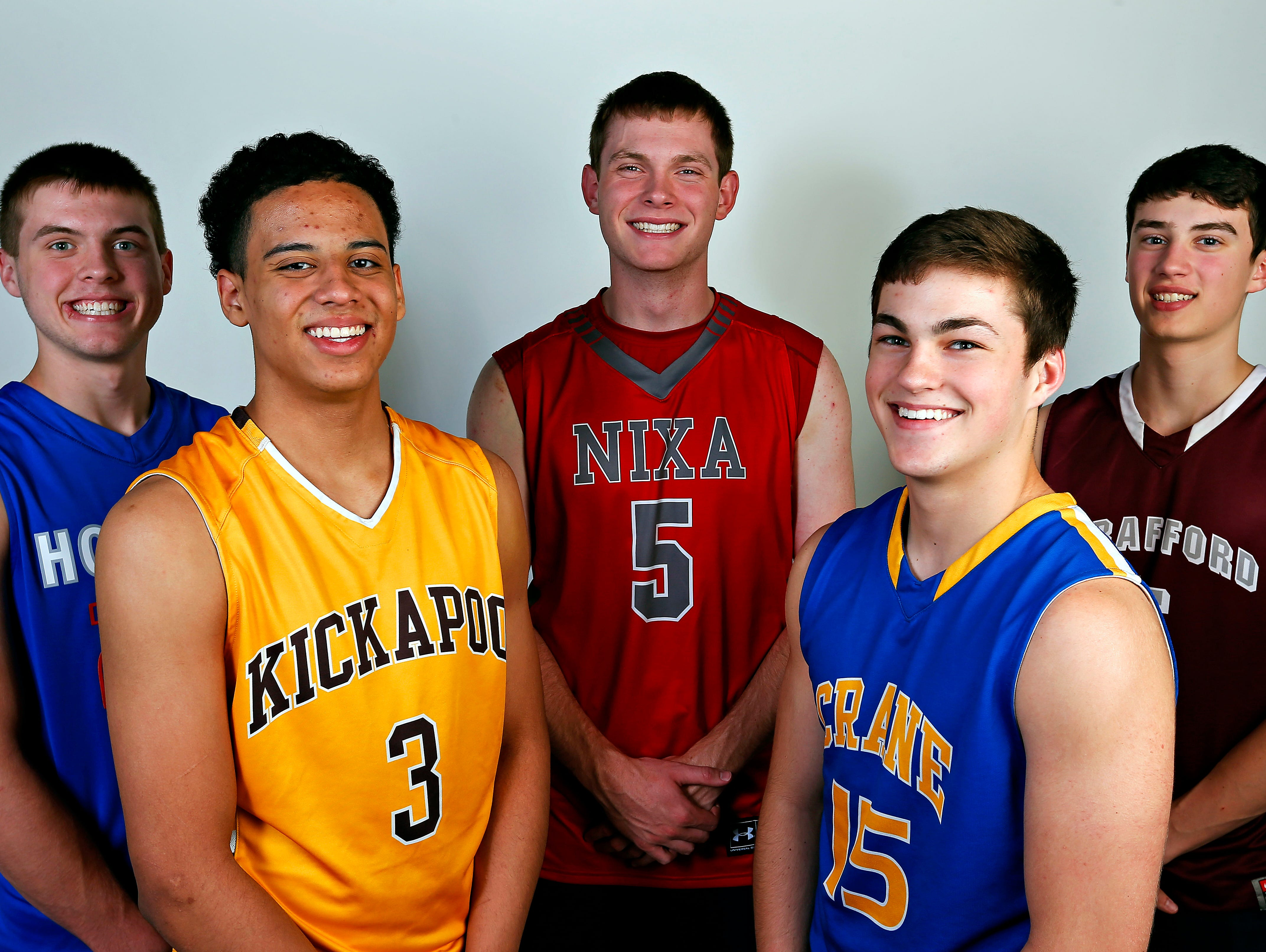 All Ozarks basketball team members (from left) Brady Petry of Hillcrest, Tyson Batiste of Kickapoo, Jacob Ruder of Nixa, Zach Chastain of Crane and Grant Boswell of Strafford at the News-Leader portrait studio in Springfield on Wednesday.