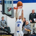 Wyoming senior Mason Rogers goes up for a dunk during the Cowboys game with Mariemont this past season.