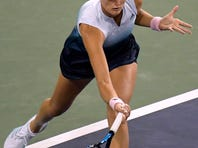 Naomi Osaka, of Japan, returns to Kristina Mladenovic, of France, at the BNP Paribas Open tennis tournament Saturday, March 9, 2019, in Indian Wells, Calif. (AP Photo/Mark J. Terrill)