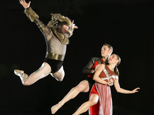 """Aslan the lion (danced by Alex Biegelson, left) faces siblings Edmund (Derek Crescenti) and Lucy (Monica Gonzalez) in the dance version of """"The Lion, the Witch, and the Wardrobe.""""  Randy James' adaptation of the C. S. Lewis novel will be staged by his 10 Hairy Legs company at NJPAC in Newark for three performances on Jan. 30 and 31."""