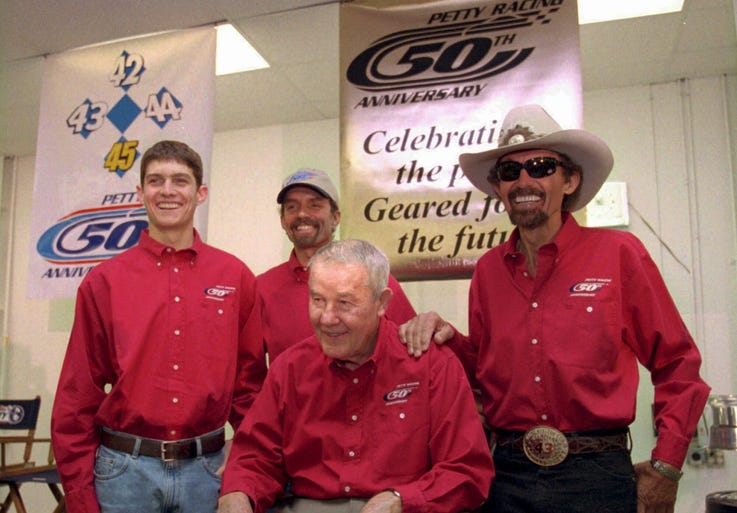 The Pettys: Lee Petty, front, is joined by his son Richard, right, grandson Kyle, second from left, and great-grandson Adam. All four generations drove in NASCAR's Cup series. Richard holds career records with 200 victories, seven series championships and seven Daytona 500 wins.