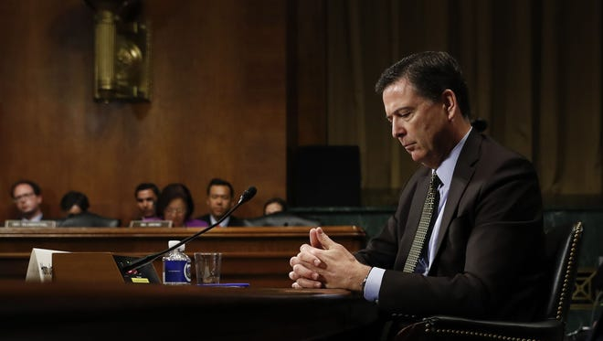 In this Wednesday, May 3, 2017, May 3, 2017, photo then-FBI Director James Comey pauses as he testifies on Capitol Hill in Washington, before a Senate Judiciary Committee hearing.
