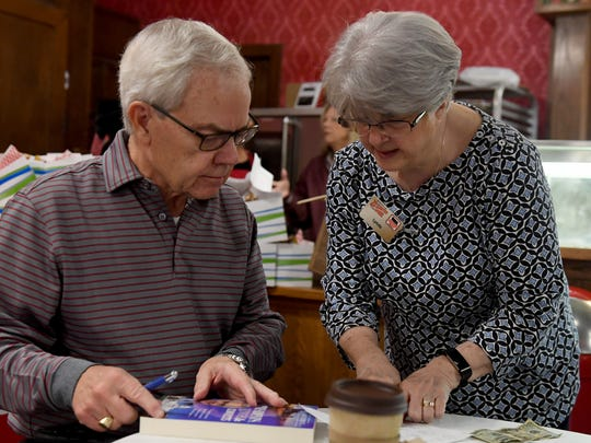Former U.S. Congressman Bob Clement (D-TN) gets instruction from Lynda Englert on how she wants her book signed, Wednesday. The former congressman signed books for the public at Brooks Shaw's Old Country Store.