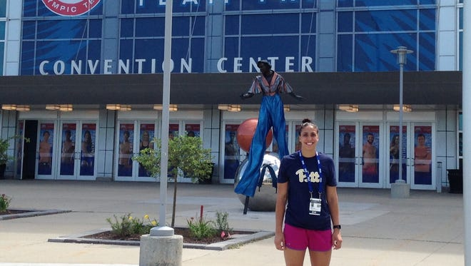 Lourdes graduate Blair Wegescheide poses outside the site of Monday's U.S. Olympic Trials in Omaha.