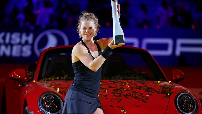 Laura Siegemund of Germany celebrates with her trophy during the award ceremony after beating Kristina Mladenovic in the final match at the Porsche Grand Prix.