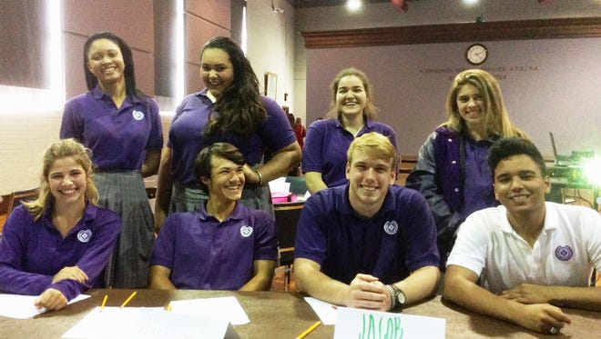 Opelousas Catholic took first place in the Lafayette Diocese Quiz Bowl tournament. Pictured are varsity team members seated from left to right Madeleine Hansen, Sam Pitre, Jacob Thiel, and Alexander Cravins.  Alternate team members included those standing from left Olivia Doucet, Bethany Guidry, Emily Tromblay and Madeline Cerna.