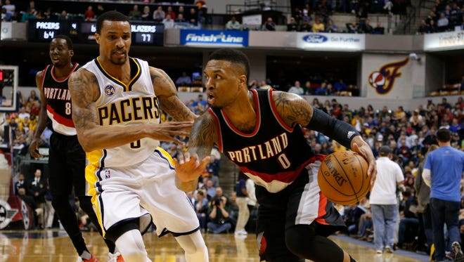Damian Lillard (0) scored a game-high 33 points for the Blazers.