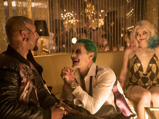 Jared Leto (center, with Common and Margot Robbie)