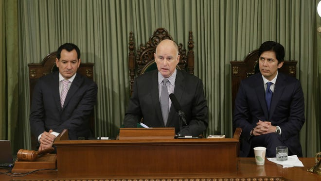 FILE - In this Jan. 24, 2017 file photo, California Gov. Jerry Brown delivers his annual State of the State address before a joint session of the California Legislature, in Sacramento, Calif. Brown will look back on his four terms as California's governor and lay out his vision for what's to come when he delivers his final State of the State address Thursday, Jan. 25, 2018. In the background are Assembly Speaker Anthony Rendon, D-Paramount, left, and Senate President Pro Tem Kevin de Leon, D-Los Angeles. (AP Photo/Rich Pedroncelli, File)