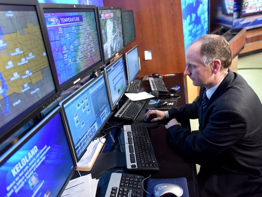 KELO-TV's meteorologist Scot Mundt monitors the weather   before the midday newscast on Monday.