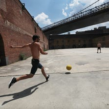 NEW YORK, NY - JULY 16:  People play kickball in Brooklyn Bridge Park on July 16, 2012 in the Brooklyn borough of New York City. A heat advisory was issued in the city again today as high temperatures were expected in the 90?s the next three days.   (Photo by Mario Tama/Getty Images)