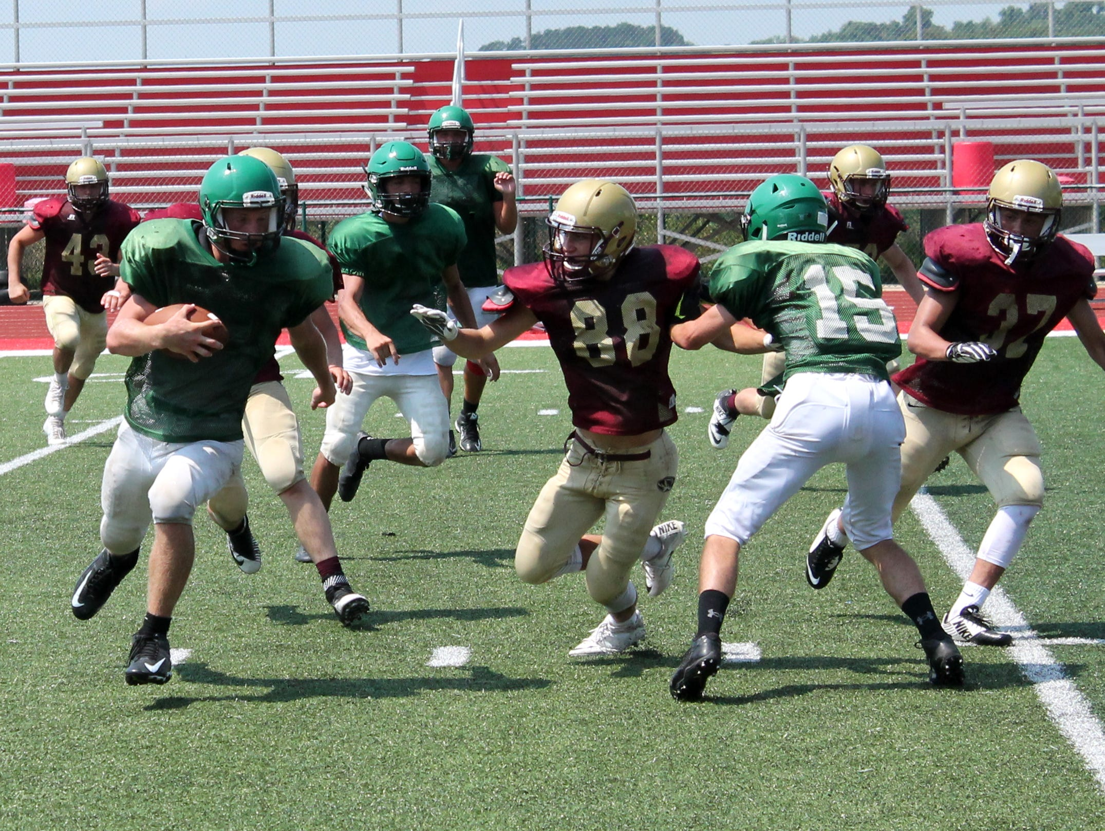 Mt. Vernon tight end Tristan Dennis (left) advances the ball against the Eldon defense in a scrimmage at the 2016 Branson Team Camp.
