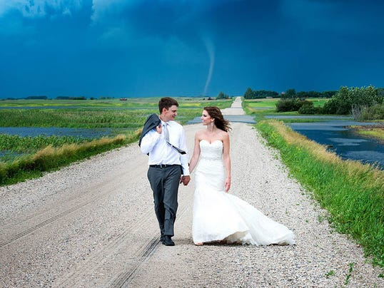 tornado forms in background of wedding photos