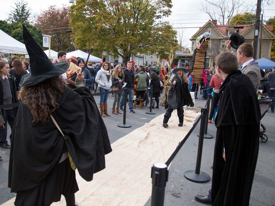 Pairs of witches and wizards faced off in ferocious, but well-mannered Wizard Duels in the parking lot next to Press Bay Alley.