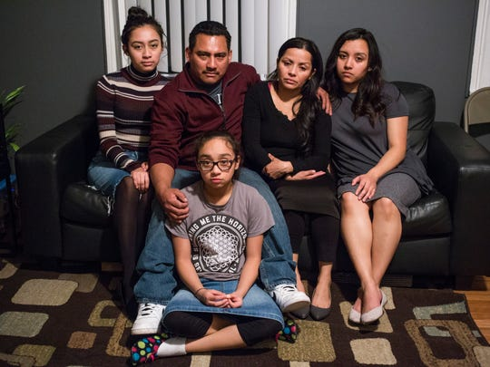 The Hernandez  family, from left on the couch, Lucero, Mario, Matilde, and Estrella Hernandez, and on the floor, Diana, at their home in Detroit on Tuesday, March 28, 2017.