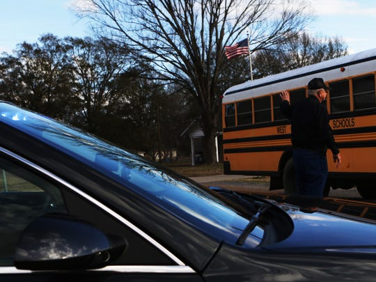 "Bob Smith, 85, directs traffic so school buses can leave to take students home from Forest School on Wednesday, January 11, 2017. Smith is Forest's only police officer and has served as the village's police chief since 1998. He is the oldest elected official in Louisiana. ""I wouldn't be doing anything if I wasn't doing this,"" he said. Smith has named the 2017 Law Enforcement Officer of the Year by the Louisiana Justice Hall of Fame."