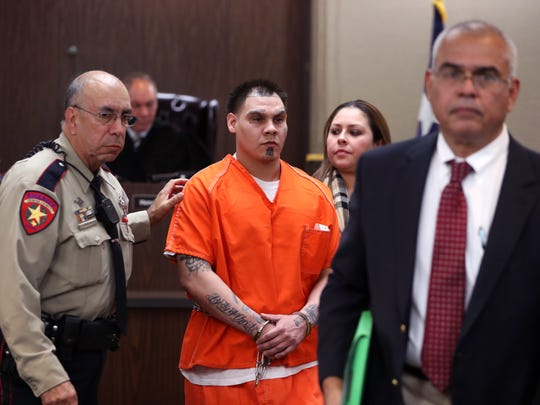 Joseph Tejeda (from left)  walks with his attorneys Dee Ann Torres and Fred Jimenez following a hearing before 105th District Court Judge Jack Pulcher on Thursday, January 4, 2018. Tejeda is accused in the death of Breanna Wood.