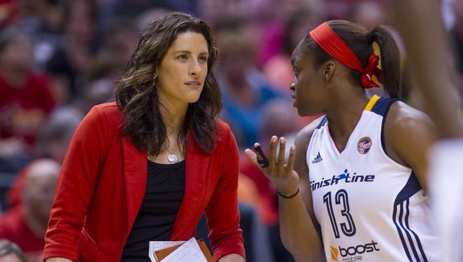 FILE -- Fever coach Stephanie White (then an assistant), talks with Karima Christmas during a break, July 12, 2014, at Bankers Life Fieldhouse.