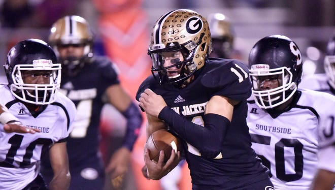 Greer quarterback Mario Cusano (11) shoots a gap in the Southside defense.
