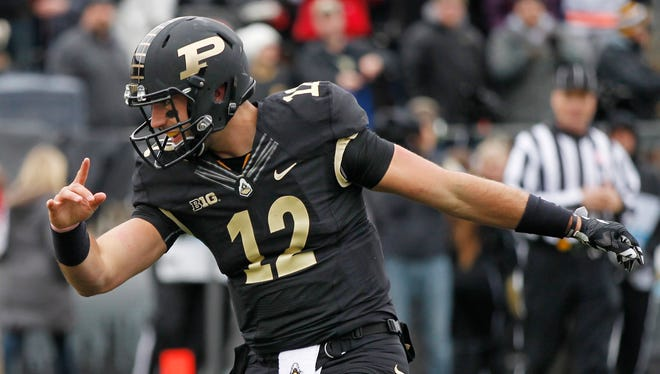 Austin Appleby takes a bow after diving into the end zone for a touchdown at the end of the first quarter against Indiana Saturday, November 28, 2015, at Ross-Ade Stadium. Appleby's score drew Purdue within three of Indiana at 10-7. Indiana beat Purdue 54-36 to retain the Old Oaken Bucket.