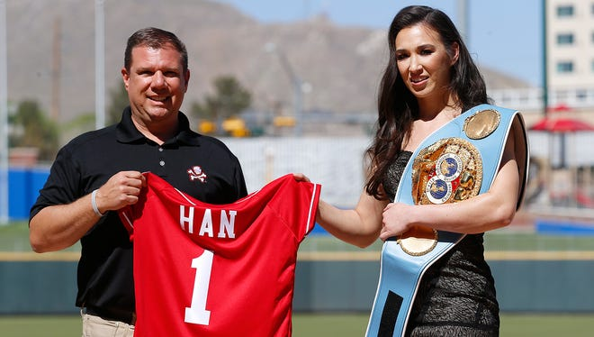 IBF World Featherweight Champion Jennifer Han of El Paso stands with Chihuahuas Brad Taylor as she was presented with an official team jersey. Han will defend her title for the first time on April 29, at Southwest University Park against number three ranked Lilian Martinez of the Dominican Republic. Han has not fought since she won her title in September 19, 2015.