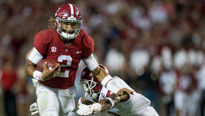 Alabama quarterback Jalen Hurts (2) carries against Arkansas in first half action at Bryant Denny Stadium in Tuscaloosa, Ala. on Saturday October 14, 2017. (Mickey Welsh / Montgomery Advertiser)