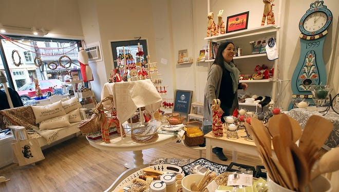 Kristin Klassert moves through her Nordiska shop as she stocks items in Poulsbo on Friday. While the Nordic Maid, a staple on Front Street, has closed, Klassert's Nordiska is picking up the baton.