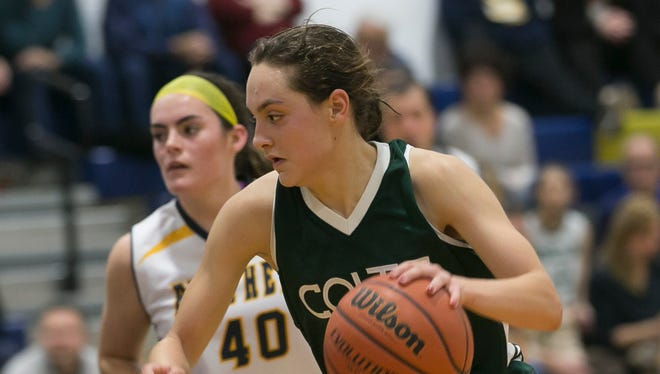 Kinnelon sophomore Taylor Smith brings up the ball as she is covered by Pequannock #40 Jess Jachera. Kinnelon at Pequannock NJAC-Independence girls basketball game at Pequannock High School. Kinnelon won 65-55; Kinnelon lead scorer sophomore Taylor Smith scored 27 points for Kinnelon. Thursday, Dec. 21, 2017. Pequannock, N.J. Karen Mancinelli/Correspondent/Daily RecordMOR 1221 GB Kinn-Peq