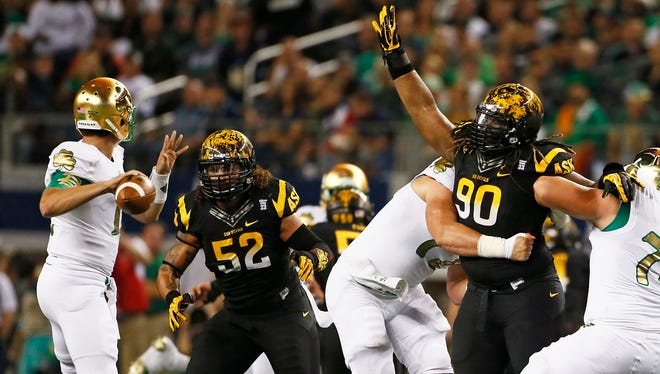 Arizona State's Carl Bradford (52) and defensive tackle Will Sutton (90) put pressure on the Notre Dame defense in the first quarter on Saturday, October 5, 2013 at AT&T Stadium in Arlington, TX.