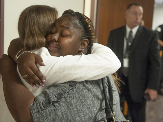 Shandar Parker, facing camera, hugs Camden County Assistant Prosecutor Rachael Minardi, in the Superior Court of Camden County Thursday after Byaer Johnson, 28 of Sicklerville, was sentenced to 60 years in prison Thursday for attempted murder and other offenses for the shooting of his and Parker's daughter in 2013. The girl, who was 11-years-old at the time, sustained life-threatening injuries, but survived. 07.30.15
