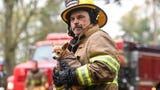 Fireman carries shivering chihuahua from fire scene