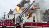 Firefighters rescued two people at a fire which destroyed a restaurant and apartments on Main St in Passaic NJ
