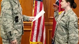 A video of a Tennessee Air National Guard public affairs officer using a dinosaur hand puppet during her re-enlistment ceremony has provoked outrage.
