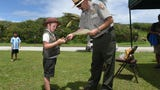 Kids take an oath to become junior rangers during National Junior Ranger Day at the War in the Pacific National Historical Park on April 21, 2018.