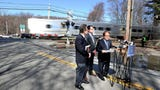 State Sen. David Carlucci and Assemblyman Tom Abinanti, along with Alan Brody, wife of Ellen Brody, demanded action on rail crossing safety.