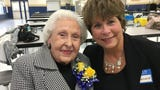 A dozen students gather at Gra-Mar school in Nashville to honor Mrs. Marie Wiggins, who taught them in the 1960s