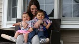 WATCH: On Mother's Day, twins bring happiness to police officer's widow