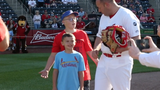 Lt. Bruce Miller put on a catcher's mask and surprised his 2 sons who threw out the first pitch. They didn't know he had returned home from Afghanistan.